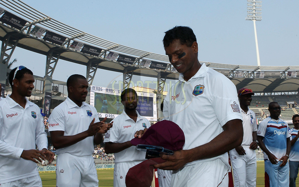 Shivnarine Chanderpaul of West Indies with his 150th test cap during day one of the second Star Sports test match between India and The West Indies held at The Wankhede Stadium in Mumbai, India on the 14th November 2013<br /> <br /> This test match is the 200th test match for Sachin Tendulkar and his last for India.  After a career spanning more than 24yrs Sachin is retiring from cricket and this test match is his last appearance on the field of play.<br /> <br /> <br /> Photo by: Ron Gaunt - BCCI - SPORTZPICS<br /> <br /> Use of this image is subject to the terms and conditions as outlined by the BCCI. These terms can be found by following this link:<br /> <br /> http://sportzpics.photoshelter.com/gallery/BCCI-Image-Terms/G0000ahUVIIEBQ84/C0000whs75.ajndY