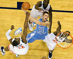 North Carolina forward Tyler Hansbrough (50) is fouled while shooting by Virginia forward Jamil Tucker (12).  The the #5 ranked North Carolina Tar Heels defeated the Virginia Cavaliers 83-61 in NCAA Basketball at the John Paul Jones Arena on the Grounds of the University of Virginia in Charlottesville, VA on January 15, 2009.