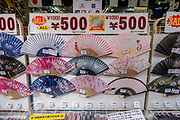 Folding fans for sale along the Philosopher's Path in Kyoto's Higashiyama district, Japan. The pleasant stone Philosopher's Path follows a canal lined with cherry trees. The 2-kilometer path begins at Ginkakuji (Silver Pavilion) and ends in Nanzenji neighborhood. A famous Japanese philosopher Nishida Kitaro was said to meditate while walking this route to Kyoto University. This is part of Lake Biwa Canal which tunnels 20 kilometers through the mountains to Lake Biwa in nearby Shiga Prefecture. Built during the Meiji Period to revitalize the stagnating local economy, the canal powered Japan's first hydroelectric power plant.
