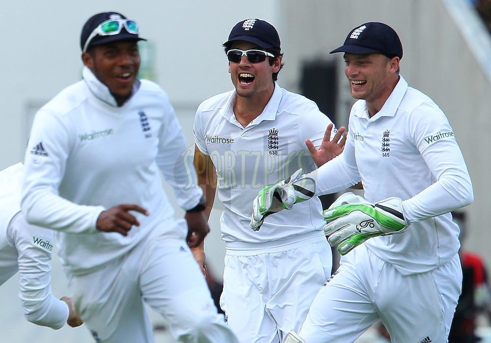 Alastair Cook captain of England celebrates the wicket of Ajinkya Rahane of India with Chris Jordan of England and Jos Buttler of England during day three of the fifth Investec Test Match between England and India held at The Kia Oval cricket ground in London, England on the 17th August 2014<br /> <br /> Photo by Ron Gaunt / SPORTZPICS/ BCCI