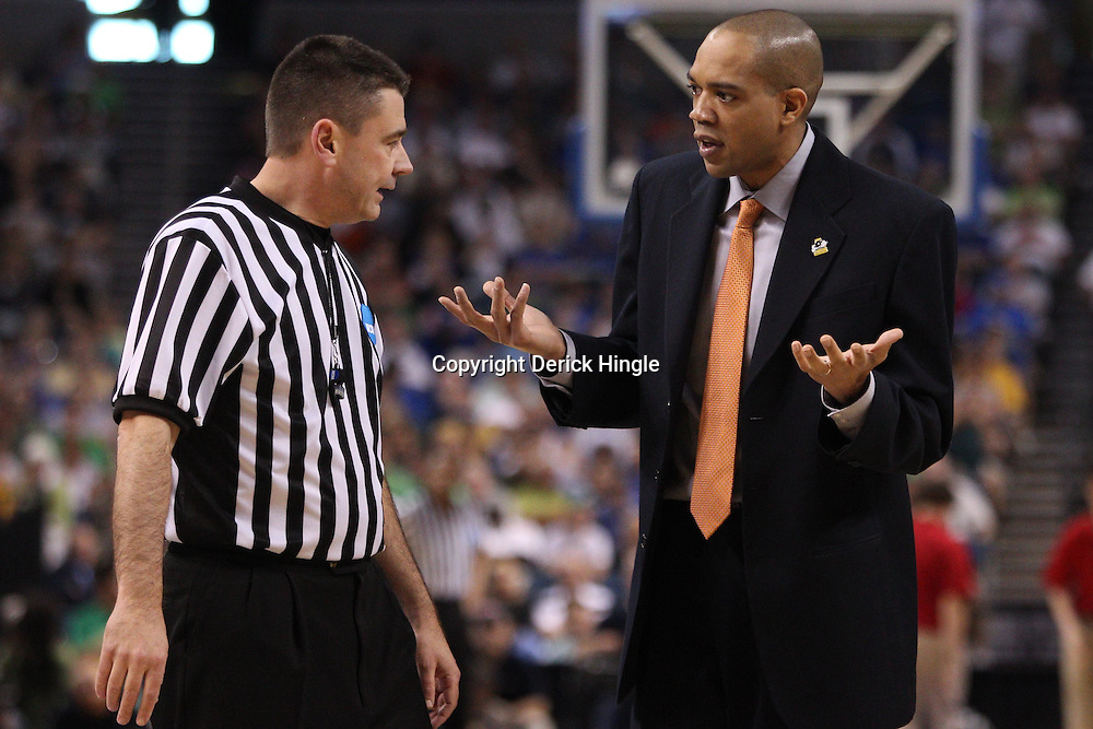 Mar 17, 2011; Tampa, FL, USA; Princeton Tigers head coach Brad Brownell argues with an official during second half of the second round of the 2011 NCAA men's basketball tournament against the Kentucky Wildcats at the St. Pete Times Forum. Kentucky defeated Princeton 59-57.  Mandatory Credit: Derick E. Hingle
