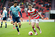 Doncaster Rovers Midfielder Tommy Rowe (Captain) (10) in action while Blackpool Defender Kelvin Mellor (2) gives chase during the EFL Sky Bet League 2 match between Doncaster Rovers and Blackpool at the Keepmoat Stadium, Doncaster, England on 17 April 2017. Photo by Craig Zadoroznyj.