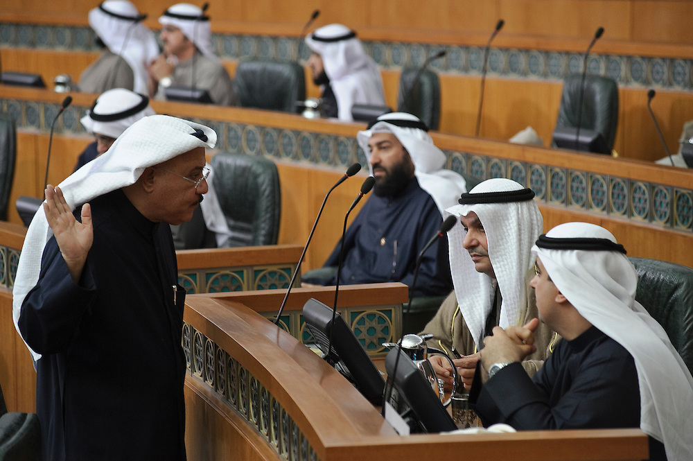 Member of Parliament Nabil Al-Fadhl gestures as he talks with MPs Ali Al-Rashed (Right) and Mohammed Al-Saqr (Left) following the state opening of the 14th legislative term's first session on Feb. 15, 2012 in Kuwait City. Kuwaitis voted on Feb. 2 for a new 50- member National Assembly (parliament).