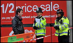 Police officers outside a Foot Locker store on Oxford Street, central London, after an 18 year old  boy was stabbed to death on Boxing Day, during the Boxing Day Sales Tuesday December 27, 2011. Photo By Andrew Parsons/i-Images