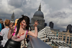 © licensed to London News Pictures. London, UK 13/10/2012. A girl with zombie make-up posing on Millennium Bridge, London as more than 2,000 'zombies' celebrating World Zombie Day on 13/10/12 in London. Photo credit: Tolga Akmen/LNP