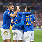 PARIS, FRANCE - March 25: Kylian Mbappé #10 of France is congratulated by team mates Olivier Giroud #9 of France and Layvin Kurzawa #22 of France after scoring his sides third goal during the France V Iceland, 2020 European Championship Qualifying, Group Stage at  Stade de France on March 25th 2019 in Paris, France (Photo by Tim Clayton/Corbis via Getty Images)