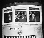 Outdoor Shot of Mayor Roger Lapham and Others Driving MSRy Streetcar 973 | September 29, 1944