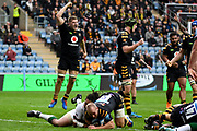 The Wasps players celebrate as Wasps scrum half Dan Robson (9) scores a try during the Gallagher Premiership Rugby match between Wasps and London Irish at the Ricoh Arena, Coventry, England on 20 October 2019.