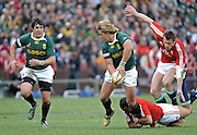 Wynand Olivier of the Springboks passes the ball to Jaque Fourie as he is tackled by Riki Flutey on the ground and Tommy Bowe of the Lions.<br /> Rugby - 090704 - Springboks vs British&Irish Lions - Coca-Cola Park - Johannesburg - South Africa. The Lions won the third test 28-9 but lost the series 2-1 to the Springboks.<br /> Photographer : Anton de Villiers / SASPA