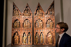 © Licensed to London News Pictures. 29/06/2016. London, UK.  A gallery owner show a shrine retable (circa 1320) made for the Spanish royal family (800k euros) at the preview, in Chelsea, of Masterpiece London, the leading international fair for art and design from antiquity to the present day with works from 154 world-renowned exhibitors on sale.  The fair is open until 6 July.Photo credit : Stephen Chung/LNP