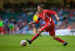 CARDIFF, WALES - Saturday, October 11, 2008: Wales' captain Craig Bellamy in action against Liechtenstein during the 2010 FIFA World Cup South Africa Qualifying Group 4 match at the Millennium Stadium. (Photo by Gareth Davies/Propaganda)