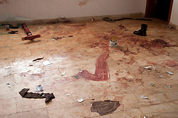 © under license to London News Pictures. 23/02/2011. Blood and clothes on the floor at the Lubrique Airport terminal in Lubrique, Libya, where 22 mecenaries loyal to Gadaffi were killed by the opposition. 600 mercenaries fought the oppostion in a firefight lasting three days. Photo credit should read Michael Graae/London News Pictures