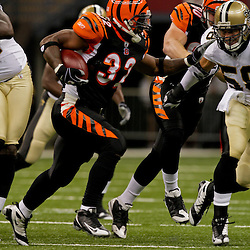 2009 August 14: Cincinnati Bengals running back Cedric Benson (32) carries the ball during a preseason opener between the Cincinnati Bengals and the New Orleans Saints at the Louisiana Superdome in New Orleans, Louisiana.