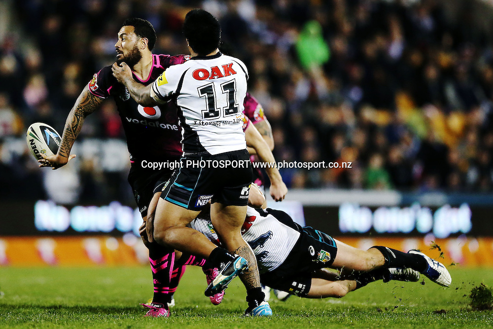 Feleti Mateo of the Warriors with an offload against Sika Manu of the Panthers. Round 16 NRL Telstra Premiership game, Vodafone Warriors v Penrith Panthers, Mt Smart Stadium, Auckland, New Zealand. Sunday 29th June 2014. Photo: photosport.co.nz