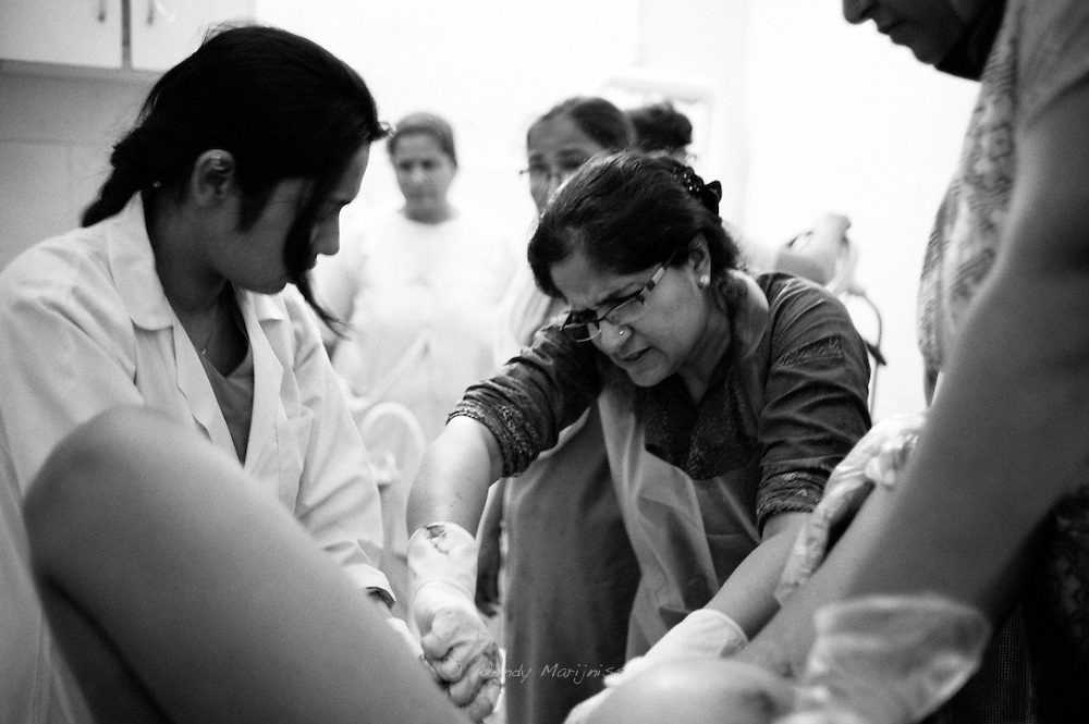 Dr. Musarat tries to deliver a baby distressed and with an alarming low heartbeat. Karachi, Pakistan, 2010