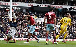 Tottenham Hotspur's Erik Lamela ends up upside down after a challenge with West Ham's goalkeeper Adrian - Photo mandatory by-line: Mitchell Gunn/JMP - Mobile: 07966 386802 - 22/02/2015 - SPORT - football - London - White Hart Lane - Tottenham Hotspur v West Ham United - Barclays Premier League
