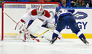 Montreal Canadiens goalie Carey Price (L) makes a save on Tampa Bay Lightning's Martin St. Louis in the shoot out during an NHL hockey game in Tampa, Florida February 12, 2013.  REUTERS/Mike Carlson (UNITED STATES)