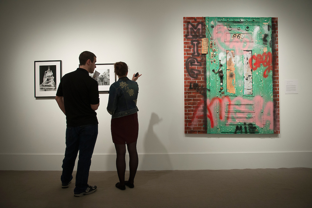 Students examine work from the Museum Studies first exhibition at the Kennedy Museum of Art. The show will run throughout the summer. Photo by Olivia Wallace