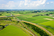 Nederland, Gelderland, Geldermalsen, 26-06-2014; Autosnelweg A15 en Betuweroute tussen Meteren en knooppunt Deil (rechts aan de horizon). Verbindingsbogen met reguliere spoorlijn Utrecht - Den Bosch,<br /> Motorway and freight railway, central Holland. Both connecting port of Rotterdam with German hinterland.<br /> luchtfoto (toeslag op standard tarieven);<br /> aerial photo (additional fee required);<br /> copyright foto/photo Siebe Swart