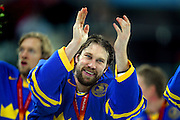 Sweden's Peter Forsberg (#21) celebrates with teammates after receiving his gold medal for their 3-2 victory over Finland in the 2006 Winter Olympics at the Palasport Olimpico in Turin, Italy on Sunday February 26, 2006. Sweden won the game 3-2 with former Colorado Avalanche player Peter Forsberg and his teammates taking home the gold medal in men's hockey..(Photo by Marc Piscotty / © 2006)