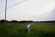 Melissa Turk, 19, picks flowers on July 1, 2006 in Eastlake, Ohio.