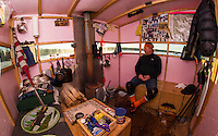 Rick Barton of Belmont sits in his Bob House looking out over Saunders Bay as he readies for the annual Great Meredith Rotary Fishing Derby this weekend.  (Karen Bobotas/for the Laconia Daily Sun)