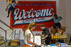 "© Licensed to London News Pictures. 17/08/2018. LONDON, UK. A handpainted welcome sign greets visitors to ""Letterheads 2018: London Calling"", an international gathering of professional sign writers and lettering artists from over 30 countries.  The event is taking place at the Bargehouse, Oxo Tower Wharf in central London untikl 19 August.  Photo credit: Stephen Chung/LNP"