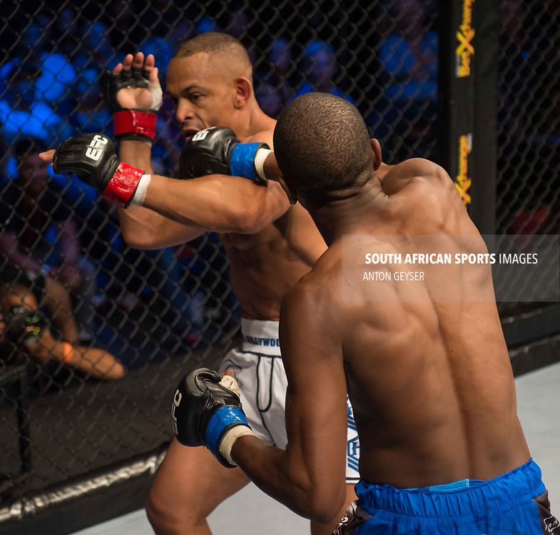 CAPE TOWN, SOUTH AFRICA - APRIL 08: Sylvester Chipfumbu punches Abdul Hassan in action  during EFC 58 at GrandWest on April 08, 2017 in Cape Town, South Africa. (Photo by Anton Geyser/EFC Worldwide/Gallo Images)