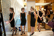 shop assistants, -Louis Vuitton openingof New Bond Street Maison. London. 25 May 2010. -DO NOT ARCHIVE-© Copyright Photograph by Dafydd Jones. 248 Clapham Rd. London SW9 0PZ. Tel 0207 820 0771. www.dafjones.com.