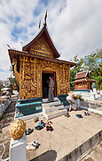 Laos. Luang Prabang. Wat Xiang Thong. Take your shoes off before entering a temple!