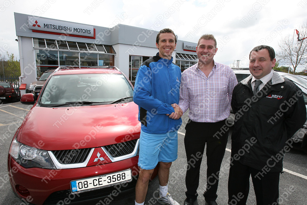 At the presentation of a Mitsubisi Outlander for a year to Clare Hurler Tony Griffin ,winner of the Clare People Sports Star of the Year were Tony Griffin,Darren Hayes (sponsor) and Laurence Mullen,Hayes of Ennis Motors.<br /><br />Photograph by Eamon Ward