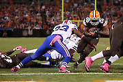 Cleveland Browns running back Willis McGahee (26) runs for a 1 yard touchdown that ties the score at 10-10 in the second quarter despite a tackle attempt by Buffalo Bills free safety Aaron Williams (23) during the NFL week 5 football game against the Buffalo Bills on Thursday, Oct. 3, 2013 in Cleveland. The Browns won the game 37-24. ©Paul Anthony Spinelli