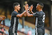 Ayoze Perez of Leicester City (17) scores a goal and celebrates with Youri Tielemans of Leicester City (8) to make the score 0-1 during the Pre-Season Friendly match between Scunthorpe United and Leicester City at Glanford Park, Scunthorpe, England on 16 July 2019.