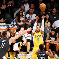 15 November 2016: Los Angeles Lakers guard D'Angelo Russell (1) takes a jump shot over Brooklyn Nets guard Yogi Ferrell (10) and Brooklyn Nets center Brook Lopez (11) during the LA Lakers 125-118 victory over the Brooklyn Nets, at the Staples Center, Los Angeles, California, USA.
