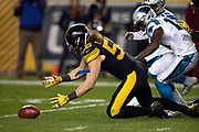 Pittsburgh Steelers linebacker Anthony Chickillo (56) recovers a third quarter Carolina Panthers fumble at the Panthers 9 yard line during the NFL week 10 regular season football game against the Carolina Panthers on Thursday, Nov. 8, 2018 in Pittsburgh. The Steelers won the game 52-21. (©Paul Anthony Spinelli)