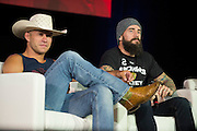 "LAS VEGAS, NV - JULY 10:  Donald ""Cowboy"" Cerrone and CM Punk look on during UFC Fan Expo Day 3 at the Las Vegas Convention Center on July 10, 2016 in Las Vegas, Nevada. (Photo by Cooper Neill/Zuffa LLC/Zuffa LLC via Getty Images) *** Local Caption *** Donald ""Cowboy"" Cerrone; CM Punk"