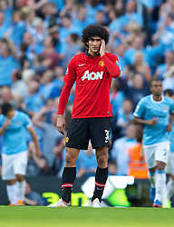 22.09.2013, Etihad Stadion, Manchester, ENG, Premier League, Manchester City vs Manchester United, 5. Runde, im Bild Manchester United's Marouane Fellaini looks dejected as Manchester City score the third goal during the English Premier League 5th round match between Manchester City and Manchester United at the Etihad Stadium, Manchester, Great Britain on 2013/09/22. EXPA Pictures © 2013, PhotoCredit: EXPA/ Propagandaphoto/ David Rawcliffe<br /> <br /> ***** ATTENTION - OUT OF ENG, GBR, UK *****
