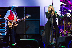 © Licensed to London News Pictures. 27/05/2015. London, UK.   Fleetwood Mac performing live at The O2 Arena, together with Christine Mc Vie who has rejoined the band.   In this picture - John McVie (left), Stevie Nicks (right).  The band are due to headline the Isle of Wight Festival next month. Fleetwood Mac are a British-American rock band consisting of members Mick Fleetwood (drums), John McVie (bass guitar), Christine McVie (keyboards/vocals), Lindsey Buckingham (guitars, vocals), Stevie Nicks (vocals, tambourine).  Photo credit : Richard Isaac/LNP