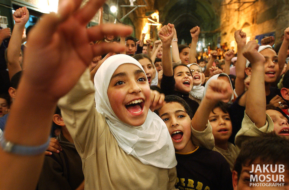 Muslim children take part in a Ramadan celebration on the streets of the Old City in Jerusalem, Israel on Thursday November 6, 2003. Photo by Jakub Mosur