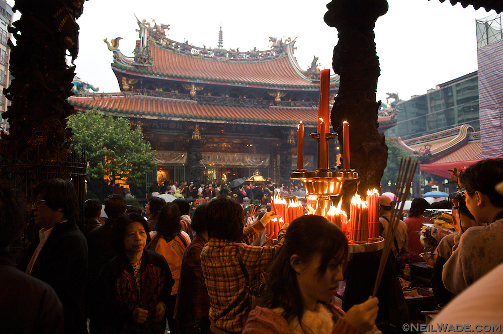 Praying at Longshan Daoist Temple in Taipei, Taiwan is considered to be very lucky on the first day of Chinese Lunar New Year.  Many people burn incense as they pray to the various deities of the temple.