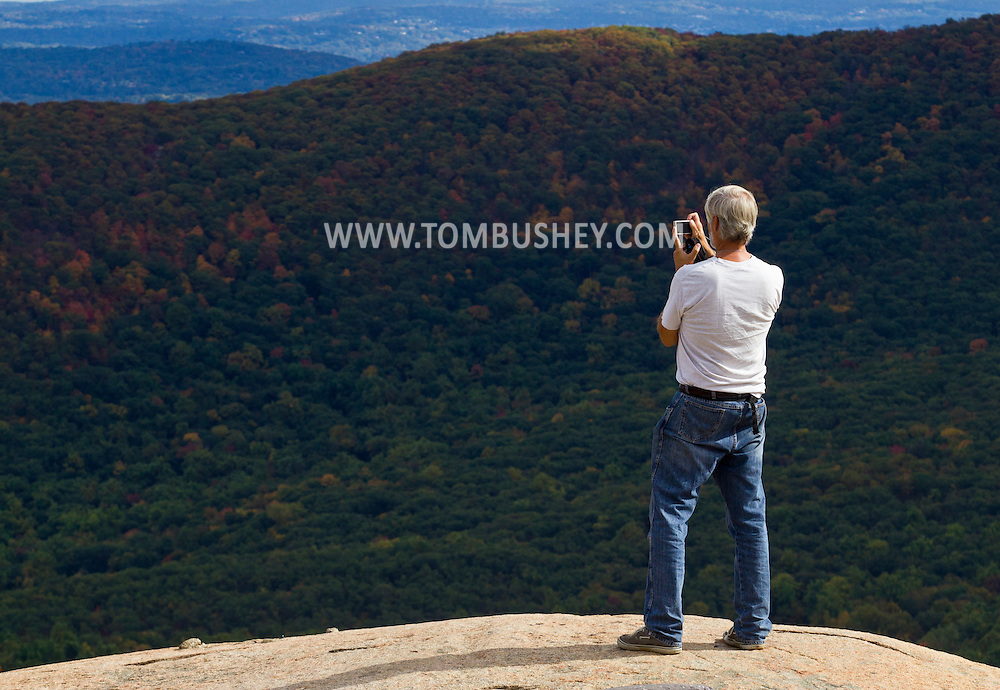 Bear Mountain, New York - A man takes photographs of the view from the top of Bear Mountain on Oct. 2, 2014.