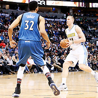 15 February 2017: Denver Nuggets center Mason Plumlee (24) drives past Minnesota Timberwolves center Karl-Anthony Towns (32) during the Minnesota Timberwolves 112-99 victory over the Denver Nuggets, at the Pepsi Center, Denver, Colorado, USA.