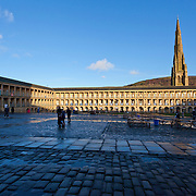 Piece Hall Halifax, in late afternoon sunshine following a heavy rain shower. Piece Hall opened in 1779 for the trading of cloth, it is now home to shops cafes and a weekly market.