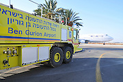 Israel, Ben-Gurion international Airport El-Al Boeing 747-400 passenger jet ready for takeoff. Emergence rescue truck can be seen on the left