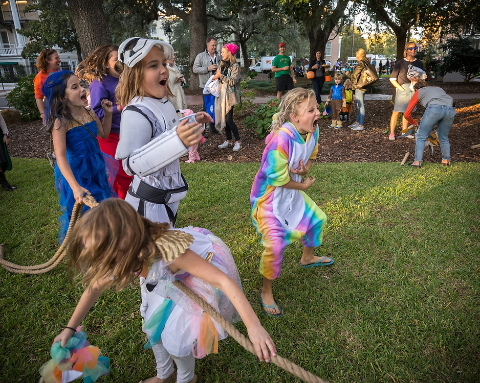 Members and guest of the Savannah Downtown Neighborhood Association enjoy the festivities during the 5th Annual Camp Spooky - a Downtown Neighborhood Halloween event - in Calhoun Square, Friday, Oct. 27, 2017, in Savannah, Ga. (DNA Photo/Stephen B. Morton)