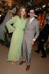 EDWARD HURST and THEA GORMLEY at the Masterpiece Midsummer Party in aid of Marie Curie Cancer Care held at The Royal Hospital Chelsea, London on 2nd July 2013.