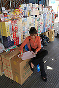 Phnom Penh, Cambodia. Central Market. Cigarette vendor.