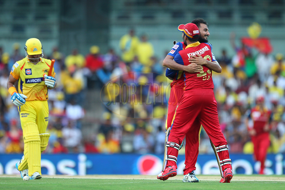 Harshal Patel of the Royal Challengers Bangalore celebrates the wicket of Suresh Raina of the Chennai Superkings  during match 37 of the Pepsi IPL 2015 (Indian Premier League) between The Chennai Superkings and The Royal Challengers Bangalore held at the M. A. Chidambaram Stadium, Chennai Stadium in Chennai, India on the 4th May April 2015.<br /> <br /> Photo by:  Ron Gaunt / SPORTZPICS / IPL