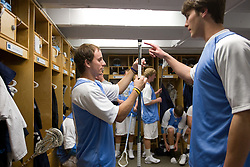 05 April 2008: North Carolina Tar Heels attackman Kevin Federico (3) helps tape the stick of defenseman Michael Jarvis (8) before playing the Virginia Cavaliers in Chapel Hill, NC.