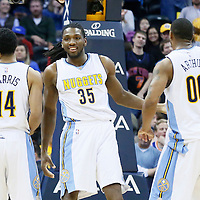08 March 2016: Denver Nuggets forward Kenneth Faried (35) is seen next to Denver Nuggets guard Gary Harris (14) and Denver Nuggets forward Darrell Arthur (00) during the Denver Nuggets 110-94 victory over the New York Knicks, at the Pepsi Center, Denver, Colorado, USA.